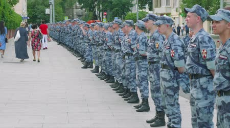 fan fest : MOSCOW - CIRCA JULY, 2018: Law forces of Russian federation wait for fans after football match betweeb Russia nad Spain in Luzhniki Stock Footage