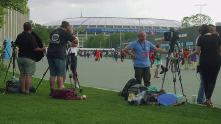 fan zone : MOSCOW - CIRCA JULY, 2018: Camera crews of different TV channels are ready to meet football fans after football match on Luzhniki