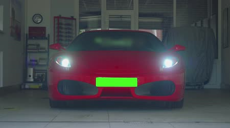 beygir gücü : MOSCOW - CIRCA JULY, 2018: Lams of red Ferrari in garage are being turned on