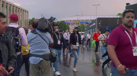 fan zone : Camera crew of Tv channel make online report about football fans after match between Russia and spain near Luzhniki stadium Stock Footage