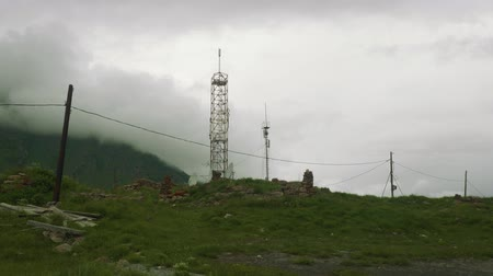 hayati : View of cell tower set using old stones high in Ossetian mountains