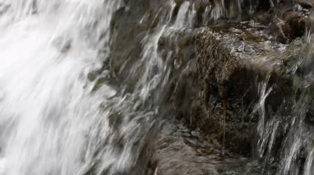 uzun : Waterfall in a forest. Clean fresh water of a forest stream running over rocks.