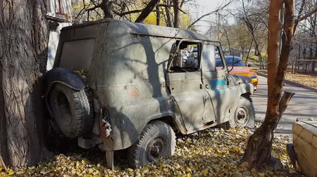 deterioration : Rusty old abandoned car. Retro old Soviet Russian jeep UAZ. Steadicam shot.