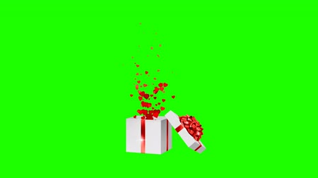 подарок : Open white holiday gift box with red bow and with flow red hearts. Valentines Day loop festive animation on the green screen background. Стоковые видеозаписи