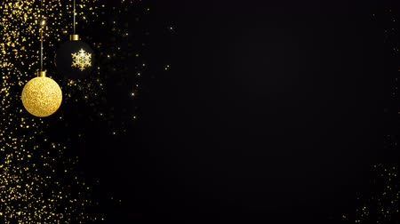 endless gold : Hanging elegant two Christmas gold evening balls on the holiday black background. Looped 4K motion graphic.