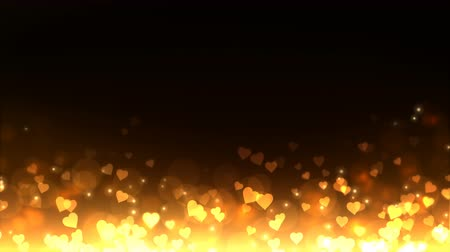 amour : Glowing hearts appear on the shining golden background. Valentines Day holiday abstract loop animation. Stock Footage