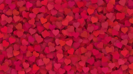 Red and pink hearts appearing on the holiday background. Looped 4K motion graphic for design Valentines Day, Mothers Day, wedding.