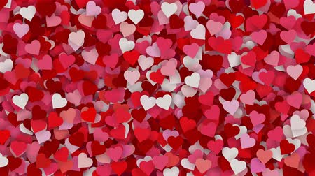 Red, pink and white paper hearts appearing on the holiday background. Looped 4K motion graphic for design Valentines Day, Mothers Day, wedding.