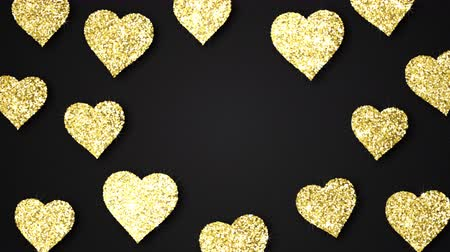 endless gold : Gold shining hearts sparkle on the black background with place for text. Valentines Day holiday abstract loop animation.