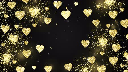 folyo : Gold shining hearts sparkle on the black background with glow animated text. Valentines Day holiday abstract loop animation. Stok Video