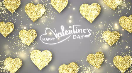 Gold shining hearts sparkle on the gray background with glow animated text. Valentines Day holiday abstract loop animation. Stock mozgókép