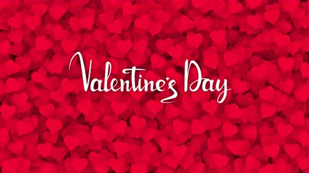escrito : Red hearts appearing on the holiday background with white text. Looped 4K motion graphic for design Valentines Day.