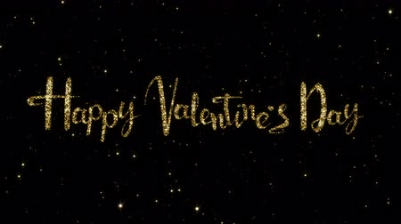 escrito : Valentines day words from shining gold particles formed on a holiday animated black background. Looped 4K motion graphic. Stock Footage