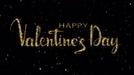 stardust : Valentines day words from shining gold particles formed on a holiday animated black background. Looped 4K motion graphic. Stock Footage
