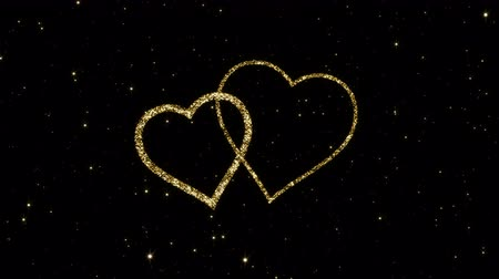 каллиграфия : Valentines day heart from shining gold particles formed on a holiday animated black background. Looped 4K motion graphic. Стоковые видеозаписи