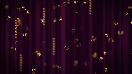 serpentine : Holiday, carnival, festive, design element falling on the purple curtain for celebration decoration, gold curly ribbons, bright serpentines. Looped 4K motion graphic. Stock Footage
