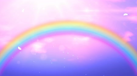 faerie : Fabulous pink background, magic sky with iridescent rainbow, sunlights and running clouds. Looped 4K motion graphic.