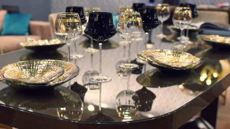 上流階級の : Table setting of luxurious glasses and plates 動画素材
