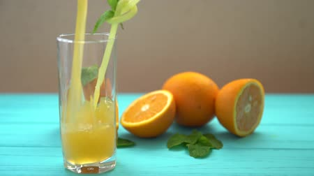 being prepared : Fresh orange juice being poured into a glass
