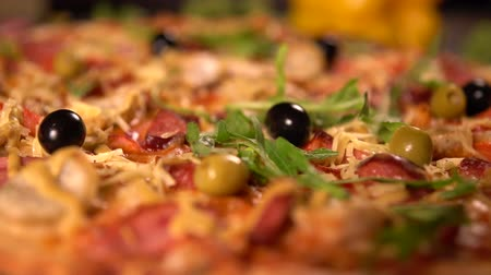 turn table : Preparing a delicious homemade pizza with herbs Stock Footage