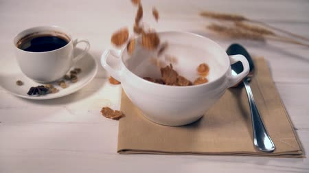 amoras : Bran flakes slowly falling and filling up bowl Stock Footage