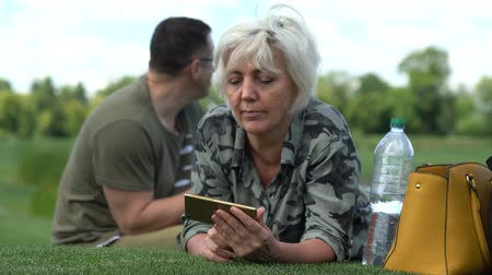 engrossed : Woman using her mobile phone outdoors Stock Footage