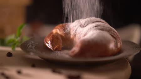 cuisine dark : Freshly baked croissant on a plate for breakfast Stock Footage