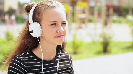 engrossed : Slow motion of a young teenager listening to music