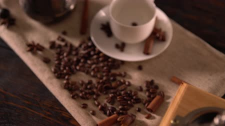 specialities : Top down of a coffee mill, beans, cinnamon and pot