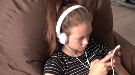 soundtrack : Young teenage girl listening to her music indoors