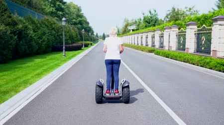 self balancing : Woman riding a Electric Personal Transporter Stock Footage
