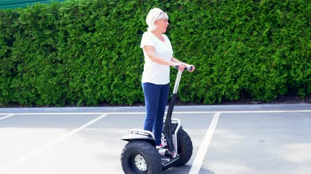 self balancing : Woman riding in circles on a Electric Personal Transporter