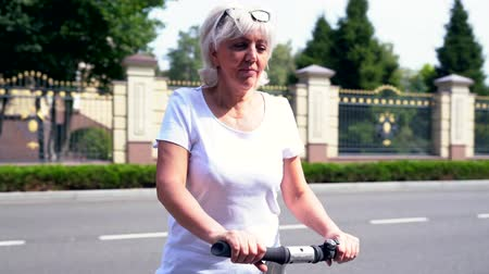 self balancing : Woman riding her Electric Personal Transporter in circles Stock Footage