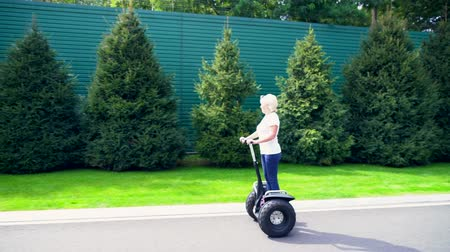 self balancing : Woman enjoying a ride on a Electric Personal Transporter