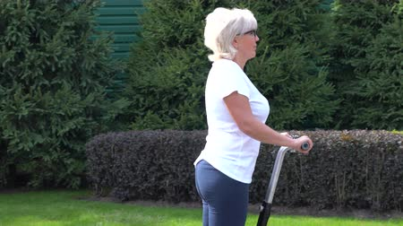 self balancing : Woman riding along on a Electric Personal Transporter