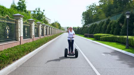 personal transporter : Woman driving a Electric Personal Transporter