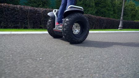 self balancing : Woman in jeans riding a Electric Personal Transporter