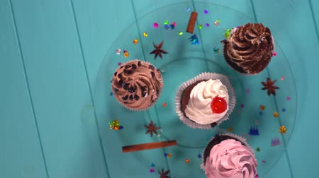 antilopa : Four decorative iced cupcakes with spices