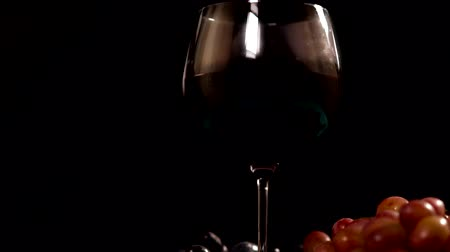 bab : Glass of red wine with fresh bunches of grapes