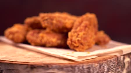 rántott : Crumbed fried chicken wings on revolving wood