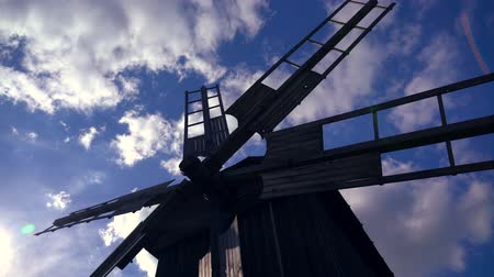 rotational : Old wooden windmill in scenic countryside