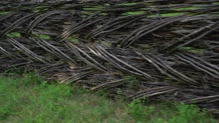 perimeter : Old woven wooden fence in a rural field