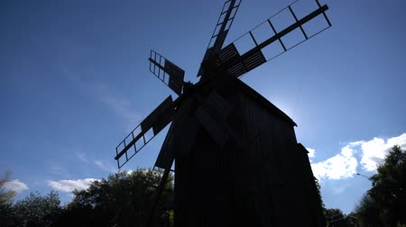 rotational : Silhouette of a traditional windmill against sky Stock Footage
