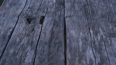 навынос : Panning across an old wooden cracked floor