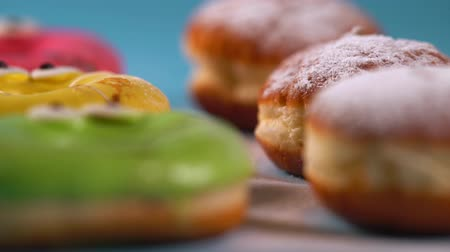 deep fried : Panning across colorful donuts and cream cakes