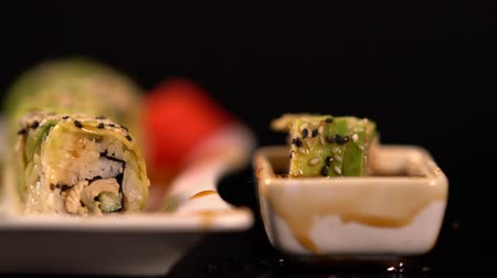 specialities : Fresh sushi roll dropping into soy sauce Stock Footage