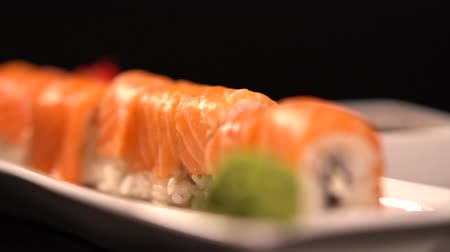 specialities : Fresh salmon sushi roll on a platter