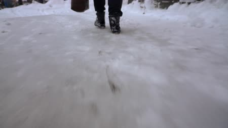 coming home : Person walking on snow covered ground