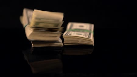graft : Five large bundles of American dollars Stock Footage