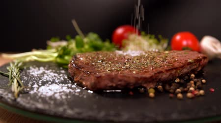 rump : Chef sprinkling salt onto a grilled rump steak Stock Footage
